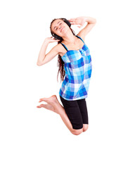 Teen girl jumping for joy on white background
