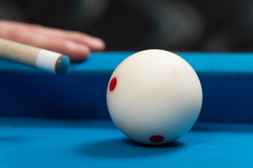 Close-Up Of A White Ball Waiting To Shoot