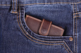 Brown wallet in the jeans front pocket