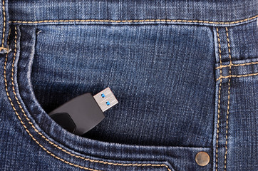 Pendrive in the pocket of blue jeans