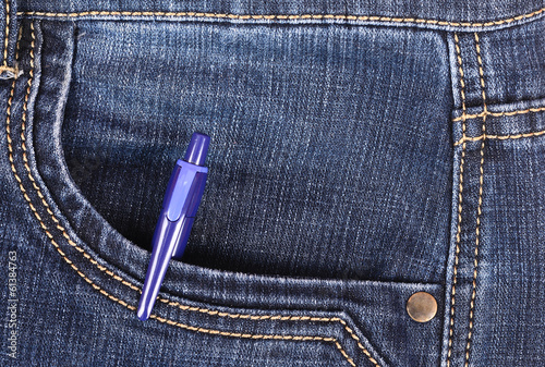 Pen in the front pocket of blue jeans
