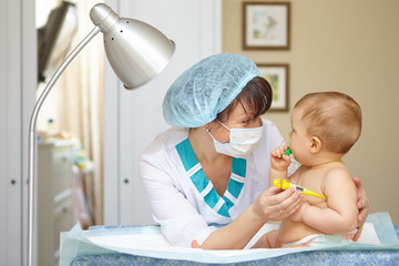 Baby healthcare and treatment. Medical symptoms. Temperature mea