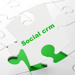 Business concept: Social CRM on puzzle background