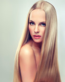 Beautiful blonde woman with long, healthy and shiny hair.
