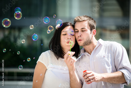 Couple have fun with bubble blower