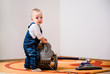 Cleaning home - baby with vacuum cleaner
