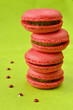 Macaroon stack on green with coulis drops