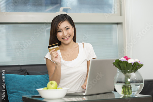Asian woman at home Shopping Online