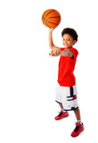 African American school boy playing basketball
