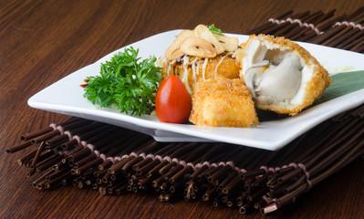 japanese cuisine. fried tofu on the background