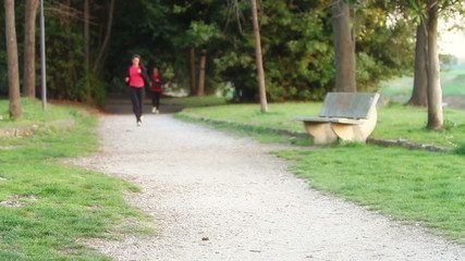 Two Young Women Running at Park