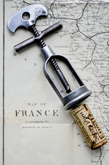antique corkscrew with Haut medoc cork and a vintage map