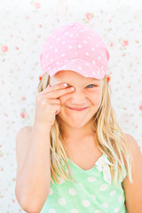 Cute happy girl covering eye