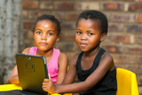 Portrait of two african youngsters with digital tablet. poster