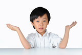 Young Asian boy making 'piece of cake' gesture with hands