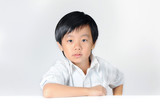 Young confident boy in white shirt