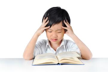 Asian boy getting headache from doing homework