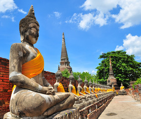 Row of Stone Buddha Statue in Ayutthaya Province, Thailand