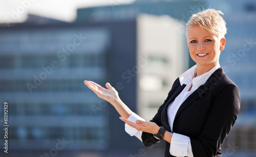 Attractive businesswoman showing to the side