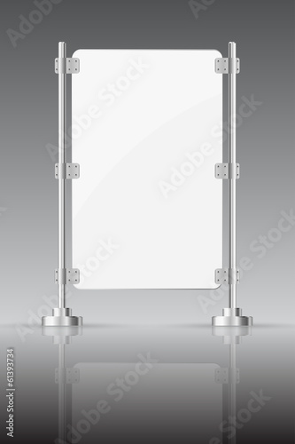 Glass screen with metal racks on a dark background with reflect