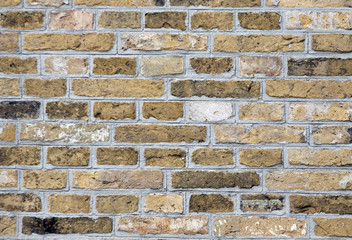 Yellow pattern brick wall image.