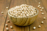 Heap of raw chickpeas in a wooden bowl