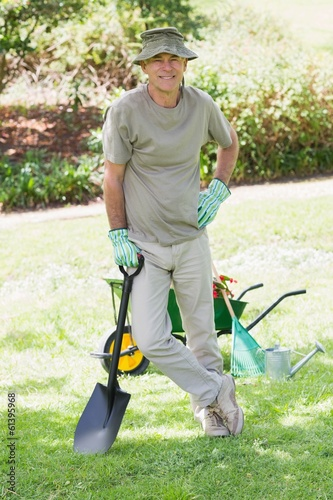 Male gardener with spade at garden