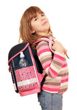 little girl carrying a heavy school bag