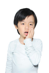 Asian boy dressed in white with tooth ache