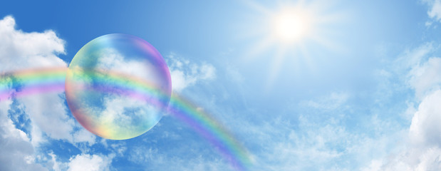 Rainbow bubble on blue sky
