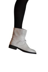 leg in grey leather boot