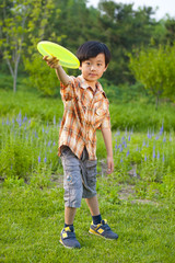 Young boy outdoor activity: playing frisbee
