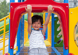 Chinese boy having fun on playground