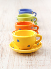 Small colorful ceramic tea cups
