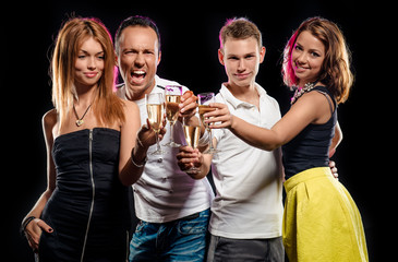 Group of young people with glasses of champagne