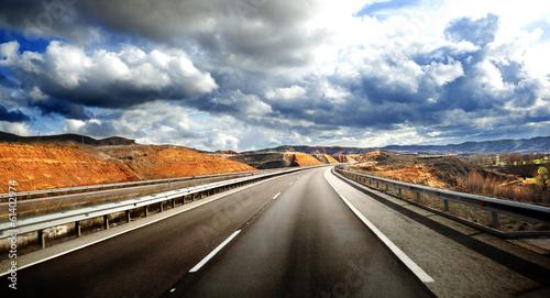 Leinwanddruck Bild Paisaje de carretera.Concepto de viaje en carretera.