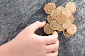 Man stacking American dollar coins