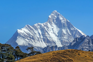 "mountain ""Nanda Devi"" against deep blue sky"