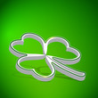 Three leaf Clover shape from paper on green background