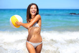 Beach woman playing with ball