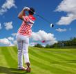 Man playing golf against blue sky