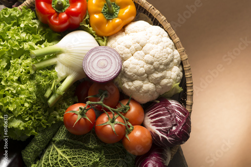 canvas print picture still life with vegetables isolated on brown background