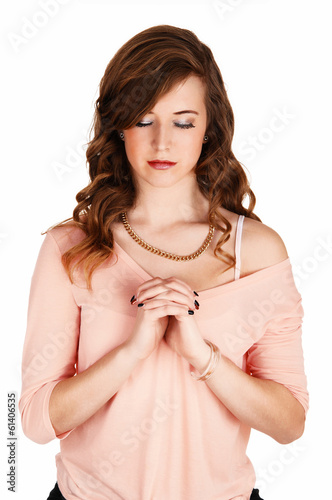 Praying young girl.