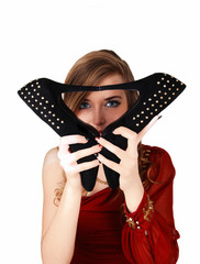 Girl holding heels.