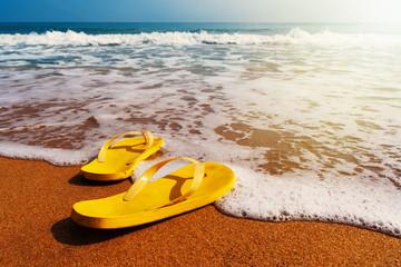 slippers on a sandy beach
