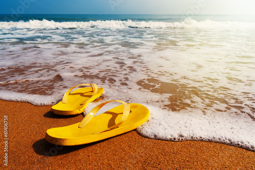 slippers on a sandy beach