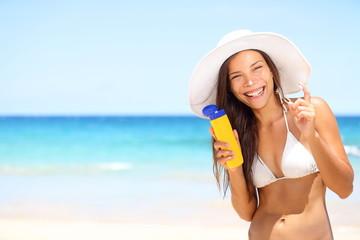 Sunscreen beach woman in bikini applying sun block