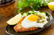 Wiener schnitzel with fried egg and capers.