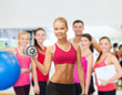 smiling woman with heavy steel dumbbells