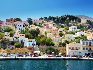 Colorful houses on hill, Symi island, Greece